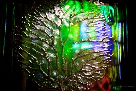 coloured glass imprinted leaf
